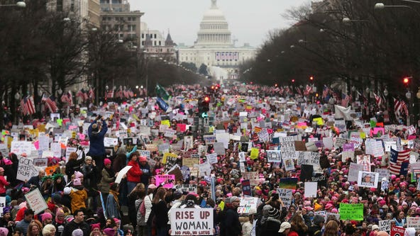 National Archives apologizes after blurring anti-Trump signs in Women's March photo