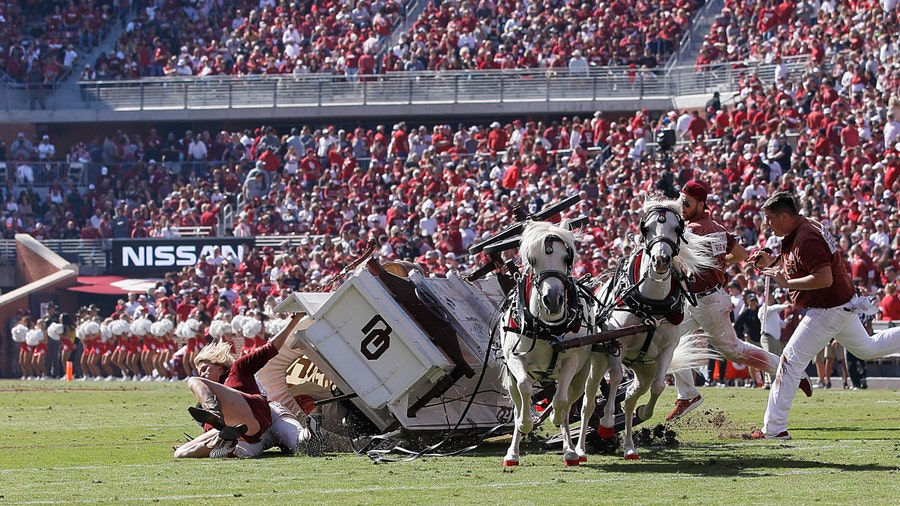 Oklahoma 'Sooner Schooner' horse-drawn wagon flips during game