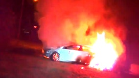 Virginia police rescue unconscious woman from burning car in dramatic bodycam video