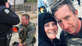Man runs race in full SWAT gear, saves a life, then proposes -- all in a matter of moments