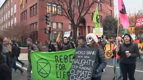 Climate change protesters march through DC streets