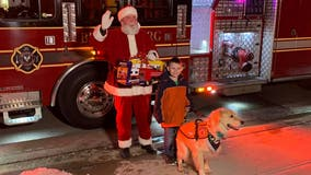 Santa makes surprise visits to two young boys who were denied meeting him over their service dogs