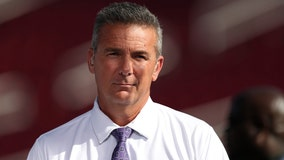 Urban Meyer watching Sunday's Redskins game from Dan Snyder's box