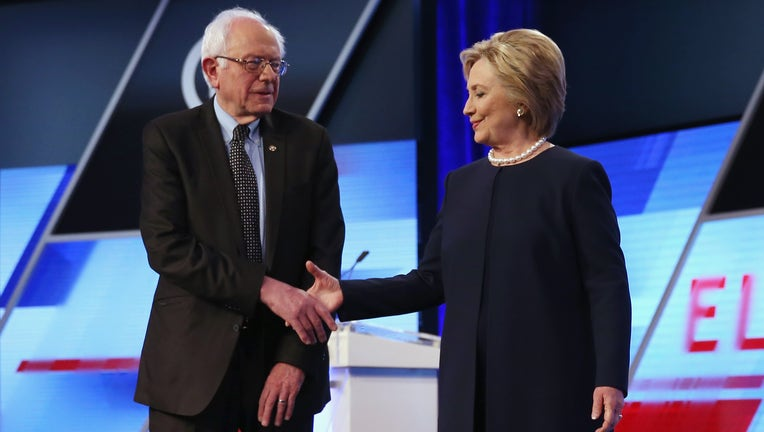 MIAMI, FL - MARCH 09: Democratic presidential candidates Senator Bernie Sanders (D-VT) and Democratic presidential candidate Hillary Clinton shake hands before the Univision News and Washington Post Democratic Presidential Primary Debate on the Miami Dade Colleges Kendall Campus on March 9, 2016 in Miami, Florida. Voters in Florida will go to the polls March 15th for the state's primary. (Photo by Joe Raedle/Getty Images)