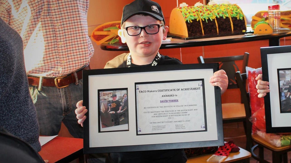 8-year-old David awarded best Taco Maker certificate during honorary employment at Taco Ball.