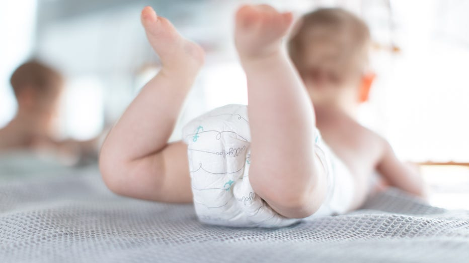 25 February 2019, North Rhine-Westphalia, Bielefeld: An infant wears Pampers while lying on a chest of drawers. Photo: Friso Gentsch/dpa (Photo by Friso Gentsch/picture alliance via Getty Images)