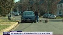 Neighborhood upset over sidewalk delay
