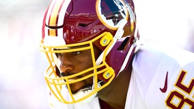 Former Washington Redskin Vernon Davis retires during Super Bowl pregame skit