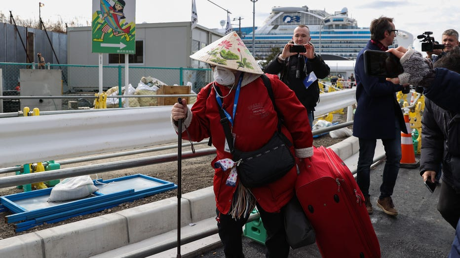 Passengers Disembark Cruise Ship After Quarantine Ends In Japan