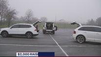 Women socialize in parking lot amid coronavirus concerns