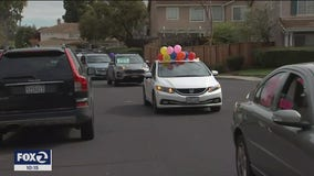 Teachers, students caravan with signs and balloons during quarantine