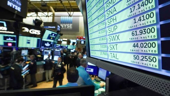 Dow slides as $2T coronavirus aid package sails through Congress