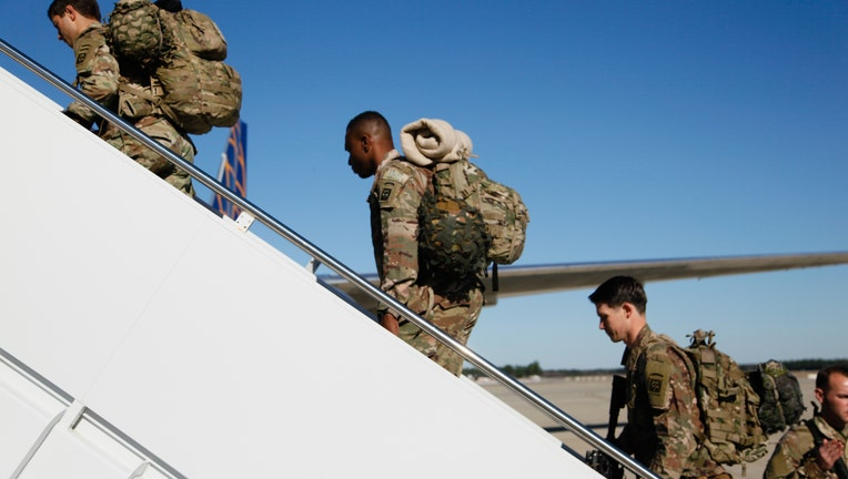 448f5452-Paratroopers assigned to 1st Brigade Combat Team, 82nd Airborne Division load aircraft bound for the U.S. Central Command area of operations from Fort Bragg, N.C.