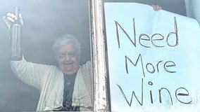 Grandma in quarantine with 'Need More Wine' sign goes viral