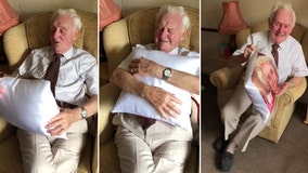 Nursing home resident cries after receiving pillow with late wife's photo on it