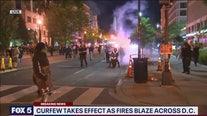 Curfew takes effect as fires blaze across DC