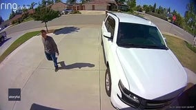 'Get out of here!': Video shows girl, 10, scare off stranger in her family's driveway
