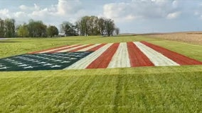 Indiana man paints giant American flag on lawn in honor of health care workers