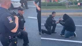 Montgomery County officers kneel in solidarity with George Floyd protesters