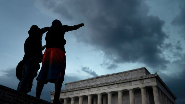 Demonstrators weather the storms in DC on seventh night of protests