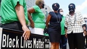 DC Mayor Muriel Bowser presents John Lewis family with Black Lives Matter Plaza sign