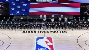 Players, coaches kneel before NBA's re-opening night