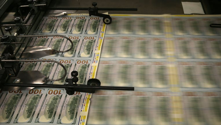 33a75d6f-Bureau Of Engraving And Printing Prints New Anti-Counterfeit 100 Dollar Bills