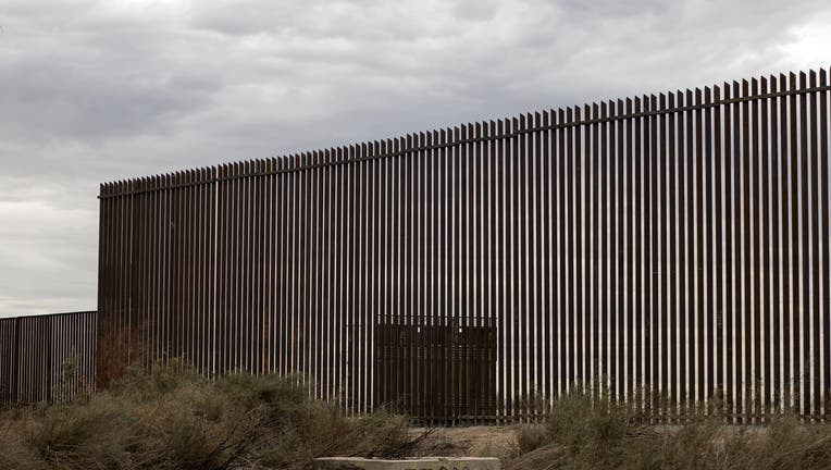 c8710b44-View of a section of the new border fence between Mexico and the US in Mexicali, Baja California state, Mexico on March 10, 2018. President Trump is expected to inspect the border wall prototypes during his visit to California on March 13. / AFP PHOTO / Guillermo Arias (Photo credit should read GUILLERMO ARIAS/AFP via Getty Images)