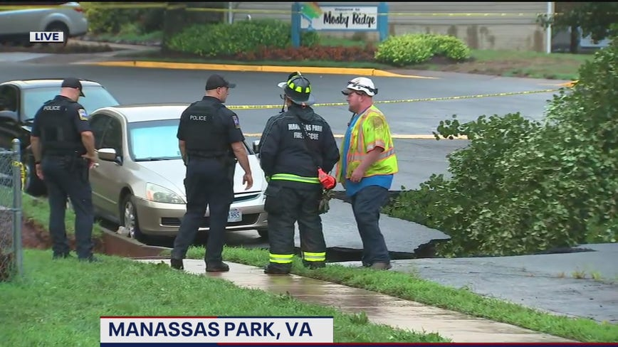 Vehicles damaged after part of road collapses after heavy rain in Manassas Park