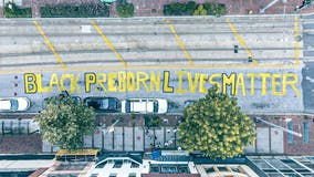 Police allow anti-abortion students to paint 'Black Preborn Lives Matter' at Planned Parenthood in Baltimore