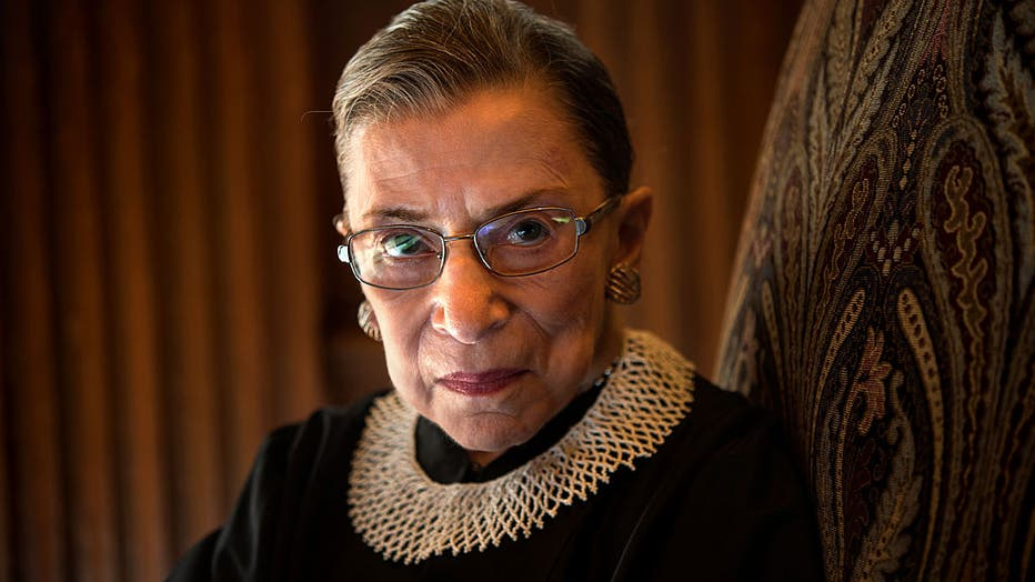 FILE - Supreme Court Justice Ruth Bader Ginsburg, celebrating her 20th anniversary on the bench, is photographed in the West conference room at the U.S. Supreme Court in Washington, D.C., on Friday, August 30, 2013.