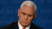 Fly on Mike Pence's head sets social media abuzz during VP debate