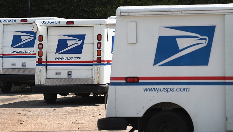 1de5d71f-United States Postal Service (USPS) trucks are parked at a postal facility on August 15, 2019 in Chicago, Illinois. (Photo by Scott Olson/Getty Images)