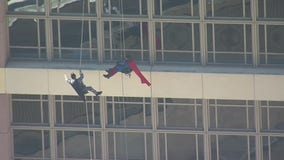 Superheroes surprise young patients at Houston's MD Anderson Cancer Center