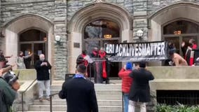 DC church re-hangs Black Lives Matter banner destroyed during protest clashes