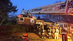 2 firefighters fall through floor in Silver Spring blaze