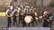 An array of performers escort President Joe Biden following his inauguration