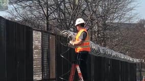 Some razorwire in the Capitol Hill area being removed