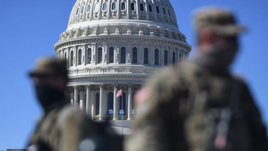 Members of the National Guard are seen patrolling near the U.S. Capitol Building on Capitol Hill on March 3, 2021, in Washington, D.C. (Photo by ERIC BARADAT/AFP via Getty Images)