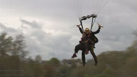 Loudoun County high school student with rare disorder parachutes onto Potomac Falls football field