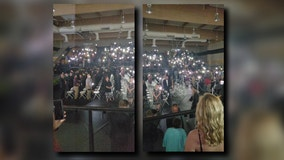 Phone flashlights save the day when power goes out during Texas graduation