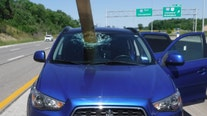 Wooden board impales windshield after flying off truck on Ohio interstate
