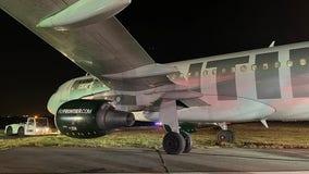 Plane slides off runway during landing at Reagan National Airport