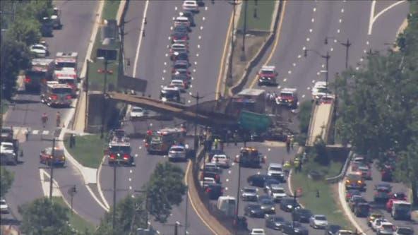 4 hurt after pedestrian bridge collapses in Northeast DC