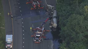 Overturned tractor trailer leaking liquid asphalt causes major delays on 495 in Montgomery County