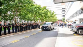 Baltimore-area cops salute officers shot in shopping center gunfight