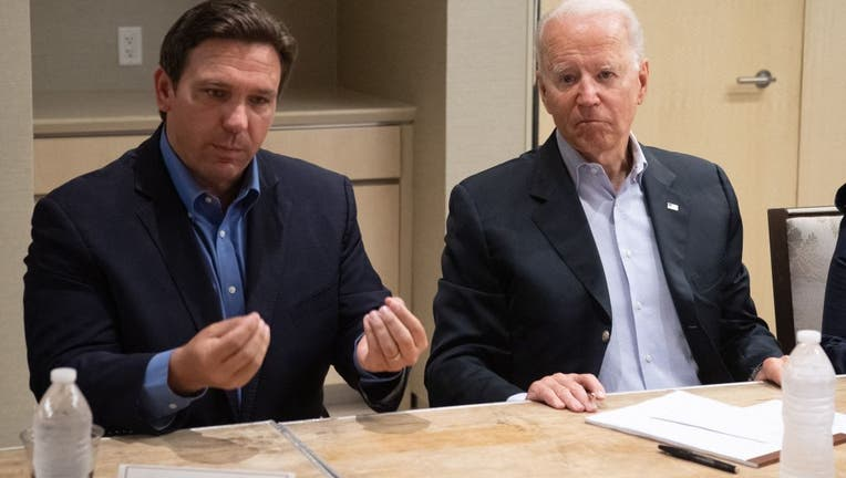 President Joe Biden alongside Florida Gov. Ron DeSantis (L) speaking about the collapse of the 12-story Champlain Towers South condo building in Surfside, during a briefing in Miami Beach, on July 1, 2021. (Photo by SAUL LOEB/AFP via Getty Images)