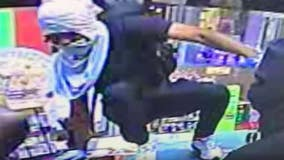 Video: Gaithersburg gas-station robbery suspect climbs over counter to threaten cashier