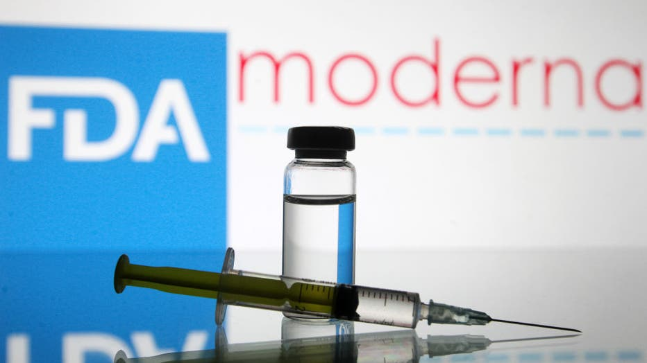 e89cc935-In this photo illustration, a vial and a medical syringe