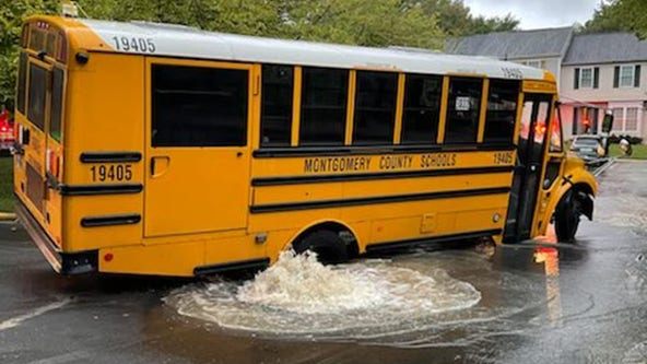 Students evacuated from Montgomery County school bus after stuck in sink hole caused by water break